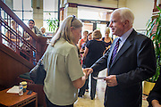 23 AUGUST 2012 - PEORIA, AZ:   Senator JOHN McCAIN (R-AZ), RIGHT, talks a supporters after a press conference in Peoria, AZ. Sen. McCain held a town hall in Peoria, AZ, a suburb of Phoenix, to talk about the impact that sequestration would have on the Arizona economy and the Department of Defense. McCain said sequestration would immediately cost Arizona more than 35,000 defence related jobs and decimate the armed forces. Sequestration would result in about $1.2 trillion being cut from the federal budget. Sequestration, and automatic budget cuts, is scheduled to go into effect on Jan 1, 2013, if the President and Congress can't agree on budget.    PHOTO BY JACK KURTZ