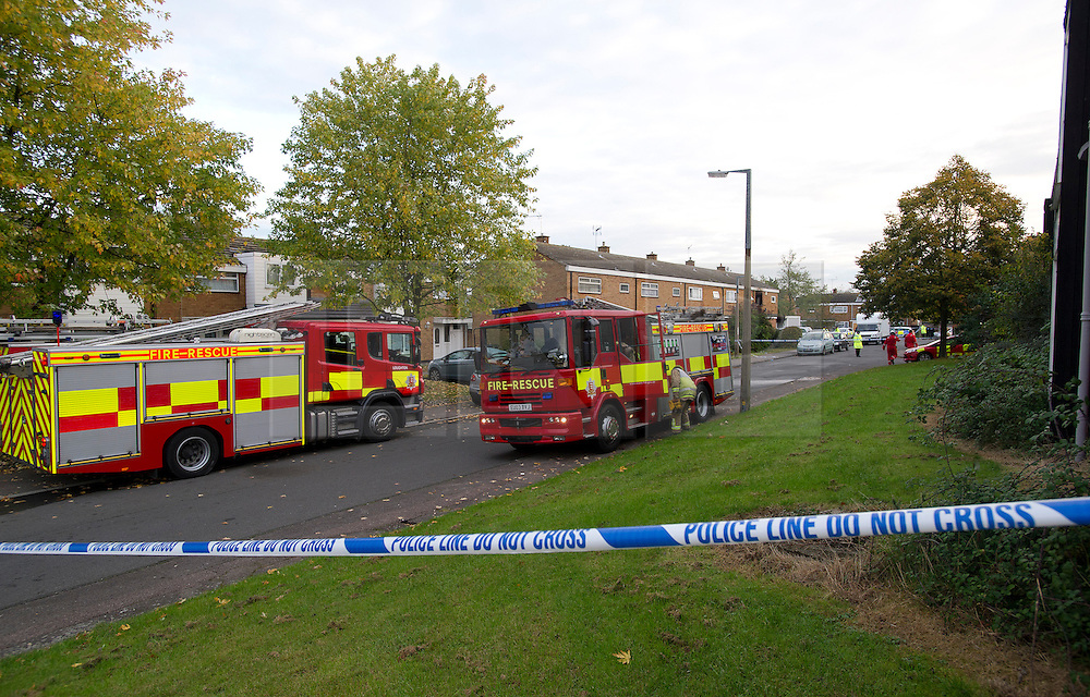 ©  London News Pictures. 15/10/2012. Harlow, UK. Fire crews and police at the scene on Barn Mead, Harlow, Essex where three children and a woman have died and three others are in hospital following a house fire. Two boys aged 13 and six, a girl aged 11 and the woman were declared dead at the scene. A nine-year-old boy and a three-year-old girl have serious burns and a man has minor burns. Photo credit : Ben Cawthra/LNP