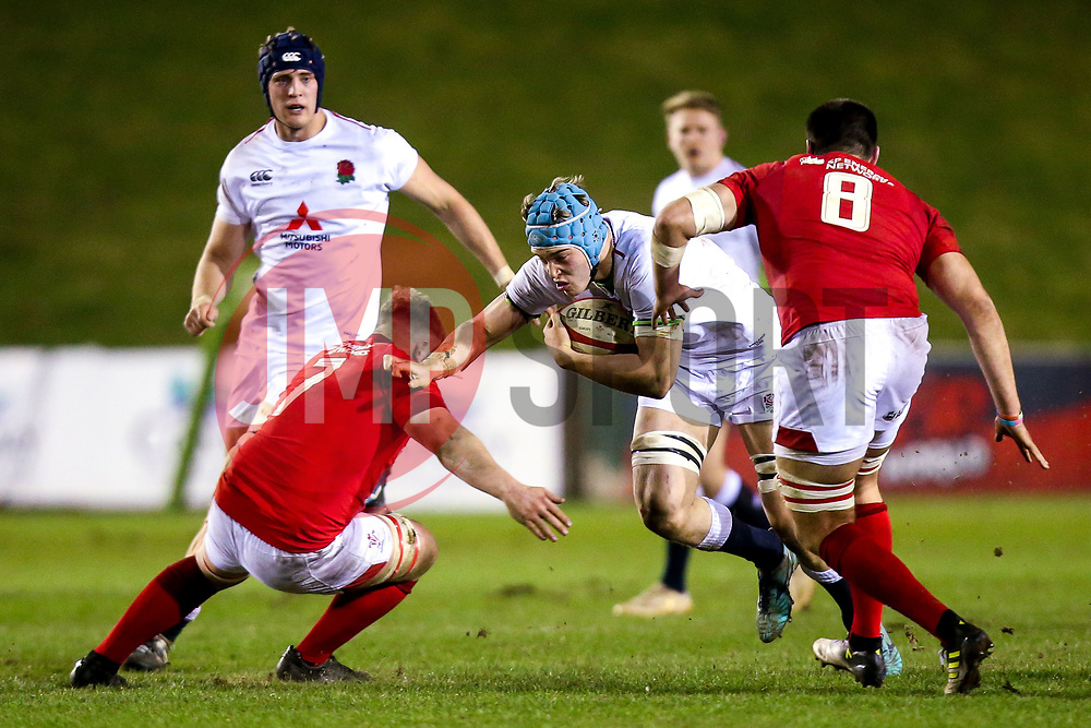 Richard Capstick of England U20 takes on Jac Morgan and Iestyn Rees of Wales U20 - Mandatory by-line: Robbie Stephenson/JMP - 22/02/2019 - RUGBY - Zip World Stadium - Colwyn Bay, Wales - Wales U20 v England U20 - Under-20 Six Nations