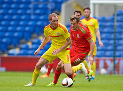 CARDIFF, WALES - Friday, June 5, 2015: Wales' Shaun MacDonald and Andy King during a practice match at the Cardiff City Stadium ahead of the UEFA Euro 2016 Qualifying Round Group B match against Belgium. (Pic by David Rawcliffe/Propaganda)