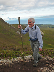 An Early Pilgrim making his way up Croagh Patrick on Reek Sunday.<br /> Photo Conor McKeown