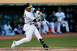 OAKLAND, CA - SEPTEMBER 21:  Ramon Laureano #22 of the Oakland Athletics at bat against the Texas Rangers during the first inning at the RingCentral Coliseum on September 21, 2019 in Oakland, California. The Oakland Athletics defeated the Texas Rangers 12-3. (Photo by Jason O. Watson/Getty Images) *** Local Caption *** Ramon Laureano