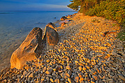 Rocky shoreline of Clearwater Lake at sunset<br />