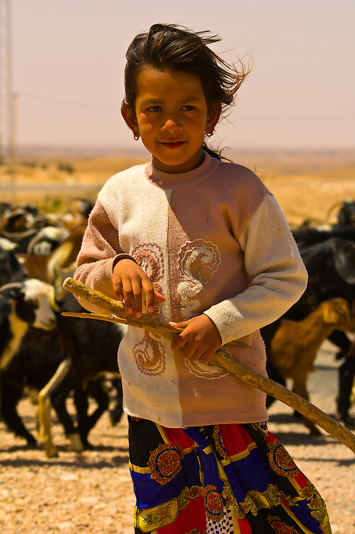 Girl herding goats in the village of Tamezret, Tunisia