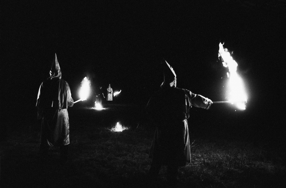 Members of the Ku Klux Klan from around the country prepare to light a cross in Osceola, Indiana. (Photo by William B. Plowman)