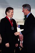 Musician Don Henley of the Eagles is presented the National Medal of Humanities by President Bill Clinton during a ceremony on the South Lawn of the White House September 29, 1997 in Washington, DC.