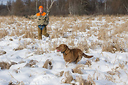 John Haugland with his Chesapeake Bay Retriever, Sage.