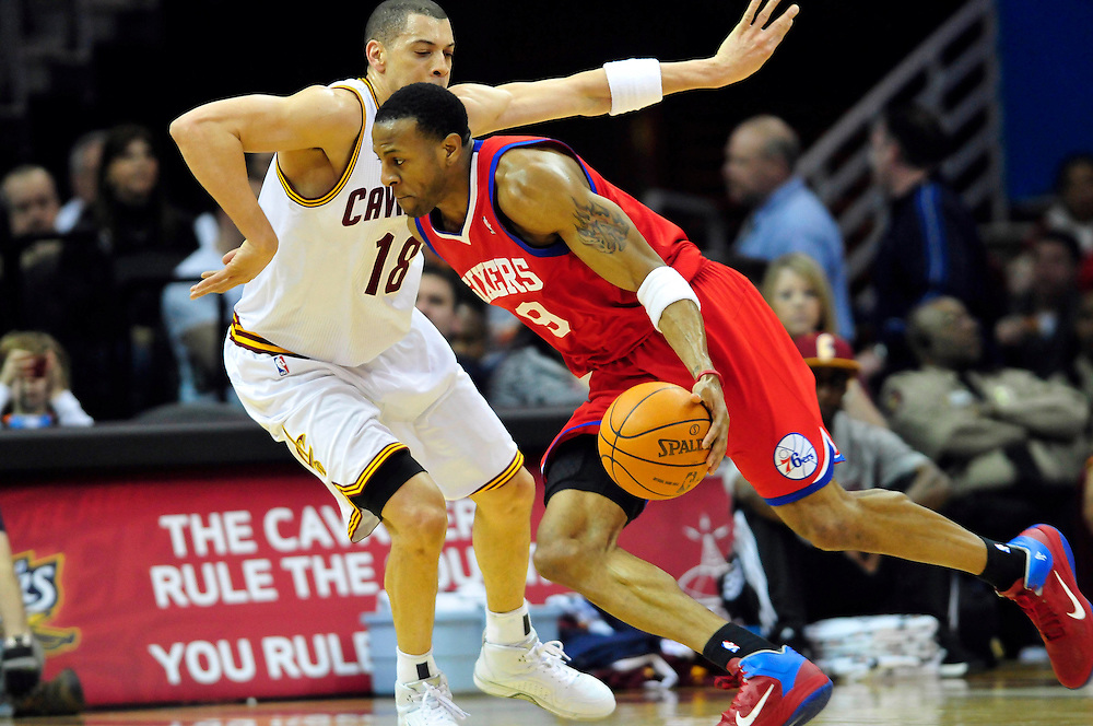 Feb. 27, 2011; Cleveland, OH, USA; Philadelphia 76ers shooting guard Andre Iguodala (9) drives past Cleveland Cavaliers shooting guard Anthony Parker (18) during the fourth quarter at Quicken Loans Arena. The 76ers beat the Cavaliers 95-91.Mandatory Credit: Jason Miller-US PRESSWIRE