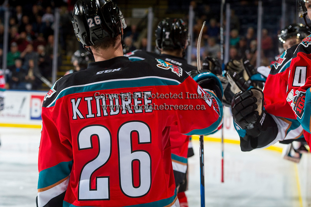 KELOWNA, CANADA - NOVEMBER 25: Liam Kindree #26 of the Kelowna Rockets fist bumps the bench to celebrate a goal against the Medicine Hat Tigers on November 25, 2017 at Prospera Place in Kelowna, British Columbia, Canada.  (Photo by Marissa Baecker/Shoot the Breeze)  *** Local Caption ***