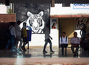 India, Rajasthan. Sawai Madhopur railway station. Tiger painting advertising Ranthambhore National Park.