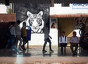 India, Rajasthan. Sawai Madhopur railway station. Tiger painting advertising Ranthambhore National Park.