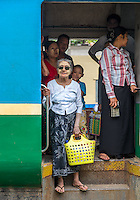 YANGON, MYANMAR - CIRCA DECEMBER 2013: Passengers in a train arriving at the Yangon Central Railway Station