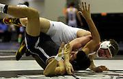 Judson's Dominic Zaleski slams Eli Urbina of Weslaco East High School during the boys' finals of the Region IV wrestling tournament at Littleton Gymnasium on Saturday, Feb. 11, 2012. Urbina won to become the 182 lb. champion.