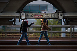 **Images taken on the evening of the 11th of August** © Licensed to London News Pictures. 11/08/2015. Calais, France. Two migrants walking along the train tracks to the Eurotunnel terminal at Frethun near Calais, northern France. . Photo credit: Ben Cawthra/LNP