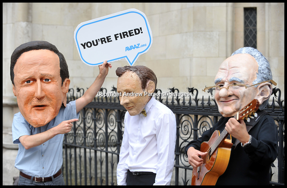 Protesters wearing Jeremy Hunt, David Cameron and Rupert Murdoch masks outside the Royal Courts of Justice as the Culture Secretary Jeremy Hunt gives evidence at the Leveson Inquiry at High Court, London, Thursday May 31, 2012.  Photo By Andrew Parsons/i-Images.Protesters wearing Jeremy Hunt, David Cameron and Rupert Murdoch masks outside the Royal Courts of Justice as the Culture Secretary Jeremy Hunt gives evidence at the Leveson Inquiry at High Court, London, Thursday May 31, 2012.  Photo By Andrew Parsons/i-Images.