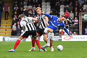 Oldham Athletic midfielder Dan Gardner (6) gets away from Grimsby Town forward Charles Vernam(18) and Grimsby Town midfielder Martyn Woolford(16)  during the EFL Sky Bet League 2 match between Grimsby Town FC and Oldham Athletic at Blundell Park, Grimsby, United Kingdom on 15 September 2018.