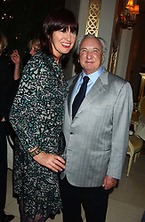 JANET STREET-PORTER and MICHAEL WINNER at The Business Winter Party hosted by Andrew Neil at The Ritz Hotel, Piccadilly, London on 7th December 2005.<br />