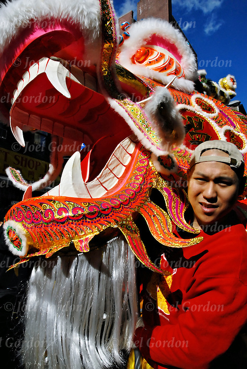 Ethnic pride and tradition in the Chinese Lunar New Year Celebration in New York Chinatown,The Year of the Rat Lion Dancing.  Two-weekend celabration in the pan-Asian community..It is the year of the Rat, the Rat is the first sign of the zodiac, as Rat people are creative problem solver, imaginative, hyperactive worker respected for its resourcefulness; intuitive with ability in acquiring and holding on to things it values.