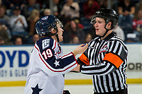 KELOWNA, CANADA - DECEMBER 5: Connor Bouchard #19 of the Tri-City Americans speaks to referee Dexter Rasmussen after a high stick to the face against the Kelowna Rockets on December 5, 2018 at Prospera Place in Kelowna, British Columbia, Canada.  (Photo by Marissa Baecker/Shoot the Breeze)