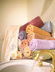 Rolled Bath Towels in a stack near the sink