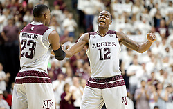 Texas A&M's Jalen Jones (12) reacts with teammate Danuel Jones (23) as timeout is called against Vanderbilt during the second half of an NCAA college basketball game, Saturday, March 5, 2016, in College Station, Texas. Texas A&M won 76-67. (AP Photo/Sam Craft)