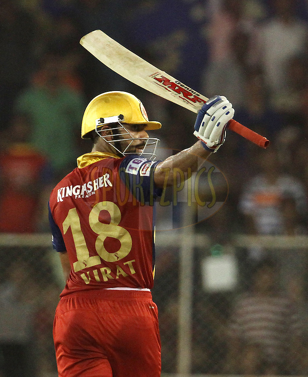 Royal Challengers Bangalore captain Virat Kohli raises his bat after scoring a fifty during match 22 of the Pepsi IPL 2015 (Indian Premier League) between The Rajasthan Royals and The Royal Challengers Bangalore held at the Sardar Patel Stadium in Ahmedabad , India on the 24th April 2015.<br /> <br /> Photo by:  Vipin Pawar / SPORTZPICS / IPL