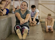 Lehi High School swimmer Amy Chapman laughs as she reaches for her prosthetic toes during dry-land practice at the Lehi Legacy Center, Tuesday, Dec. 18, 2012. Chapman, 17, was born with fibular hemimelia and had both legs amputated when she was 13 months old.