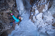 "Mountain guide and mixed climbing champion Dawn Glanc climbing ""Confinement"" M8 in the Ouray Ice Park, Ouray Colorado"