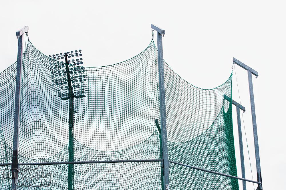 Close up photo of stadium lights against sky