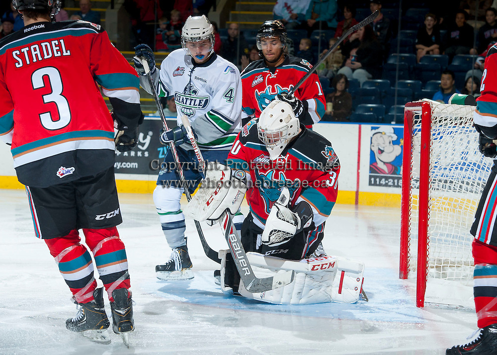 KELOWNA, CANADA - OCTOBER 11:  Jordan Cooke #30 of the Kelowna Rockets makes a save against the Seattle Thunderbirds on October 11, 2013 at Prospera Place in Kelowna, British Columbia, Canada (Photo by Marissa Baecker/Shoot the Breeze) *** Local Caption ***