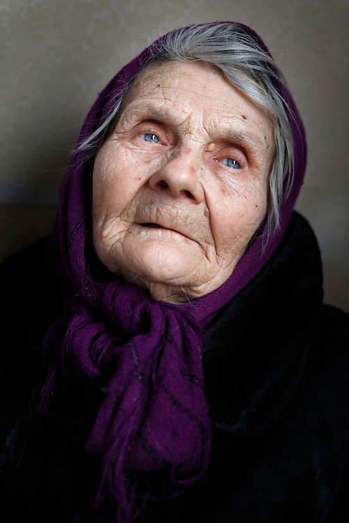 Eighty-eight year old Vera poses for a portrait on a train that has been converted into a temporary shelter on February 9, 2015 in Slavyansk, Ukraine.