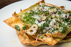 Bubbly-edged, browned pasta is a surprising and welcome touch on Arthur Ave's lasagna. (Editorial: Houston Food Finder)