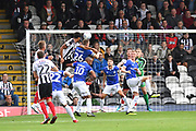 Grimsby Town defender Akin Famewo (12) heads towards goal during the EFL Sky Bet League 2 match between Grimsby Town FC and Oldham Athletic at Blundell Park, Grimsby, United Kingdom on 15 September 2018.