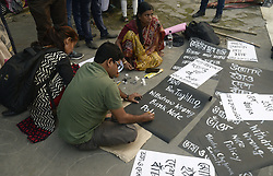 November 9, 2016 - Kolkata, West Bengal, India - A man makes a poster before a protest against the Indian government decision to withdraw of Rs.500 and Rs. 1000 bank notes across India today in Kolkata. (Credit Image: © Saikat Paul/Pacific Press via ZUMA Wire)
