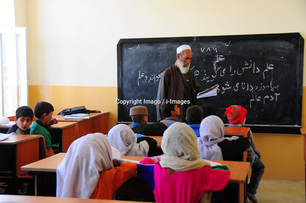 An Afghan teacher teaches during a class at a school that was funded by Angelina Jolie in Kabul, Afghanistan, on April 3, 2013. At least 400 girls study in this school founded by Hollywood star Angelina Jolie. Photo by Imago / i-Images...UK ONLY..