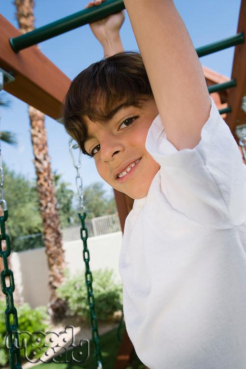 Little Boy on a Jungle Gym