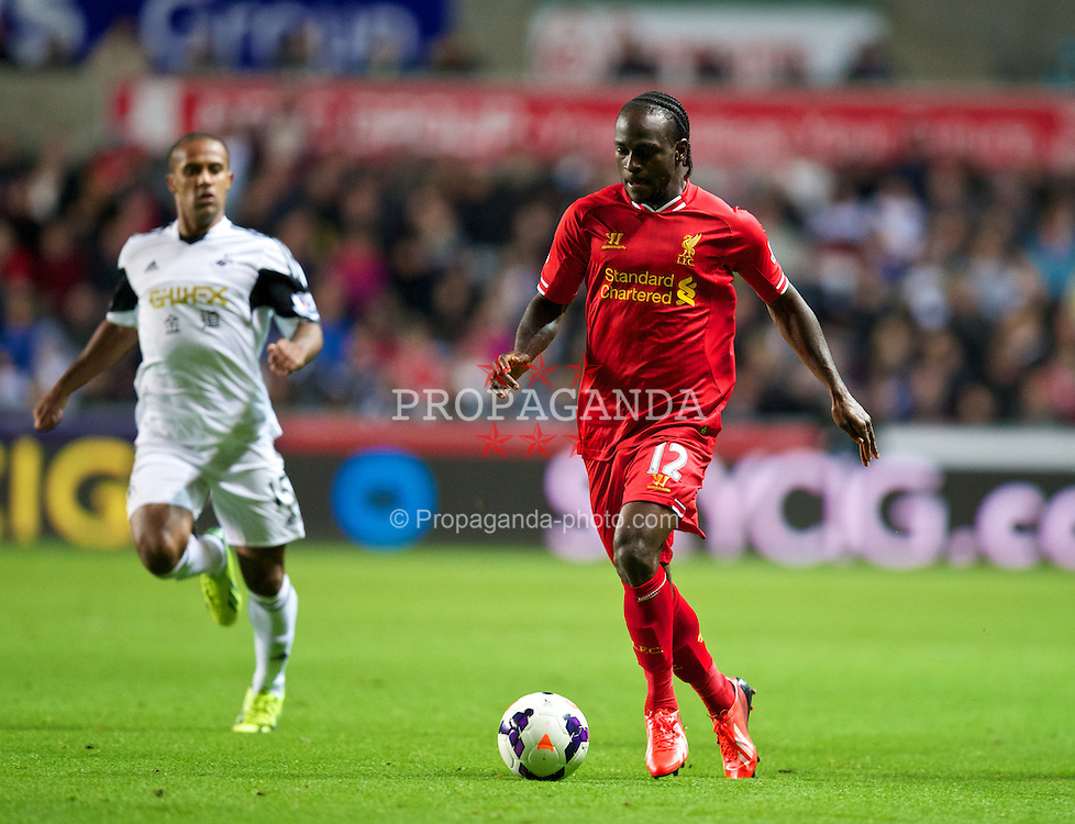 SWANSEA, WALES - Monday, September 16, 2013: Liverpool's Victor Moses in action against Swansea City during the Premiership match at the Liberty Stadium. (Pic by David Rawcliffe/Propaganda)