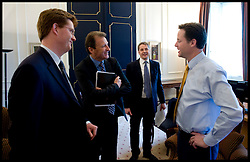 The Deputy Prime Minister Nick Clegg (right) and The Chief Secretary to the Treasury, Danny Alexander talk to Sir Gus O'Donnell Secretary to the Cabinet and Head of the Home Civil Service (2nd left with folder), and Jeremy Heywood (2nd right), currently Permanent Secretary at No. 10, inside the Prime Minister's office..The  Cabinet Secretary Sir Gus O'Donnell steps down at the end of the year and is replaced by Jeremy Heywood (left), currently Permanent Secretary at No. 10, will replace Gus O'Donnell as Cabinet Secretary. Photo By Andrew Parsons/ i-Images