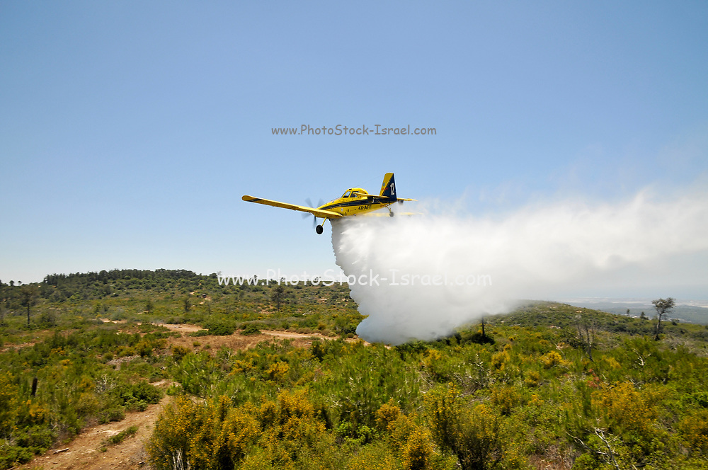 firefighting Aircraft dropping fire retardant on a fire during a practice and training session
