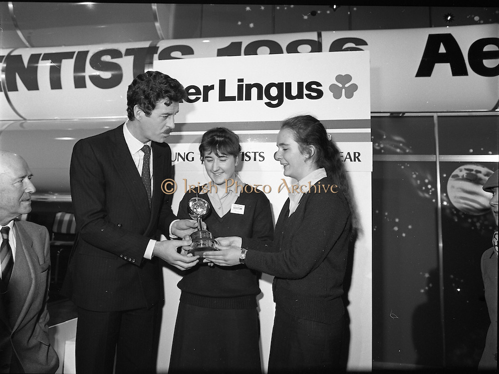 10/01/1986.01/10/1986.10th January 1986.The Aer Lingus Young Scientist of the Year Exhibition at the RDS, Dublin...Picture shows An Tanaiste, Dick Spring, T.D. presenting the Aer Lingus Young Scientist of the Year award to Breda Maguire and Niamh Mulvany, both of Rosary College, Raheny,Dublin.  .