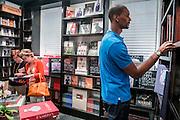 FEBRUARY 11, 2013 MIAMI BEACH, FL -   Miami Heat star Chris Bosh looks Through the books  at Books & Books along Lincoln Road in MIami Beach, FL. PHOTO BY JOSH RITCHIE/POLARIS IMAGES