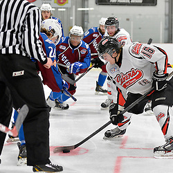 """FORT FRANCES, ON - Apr 30, 2015 : Central Canadian Junior """"A"""" Championship, game action between the Dryden GM Ice Dogs and the Fort Frances Lakers, game six of the Dudley Hewitt Cup. Lucas DeBenedet #16 of the Fort Frances Lakers wins the face-off during the second period.<br /> (Photo by Shawn Muir / OJHL Images)"""