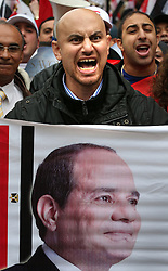 © Licensed to London News Pictures. 05/11/2015. London, UK. A man shouts in a protest near Downing Street during the visit of Egyptian President Sisi. Photo credit: Peter Macdiarmid/LNP