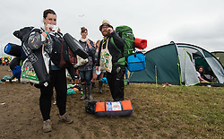 © Licensed to London News Pictures. 28/06/2015. Pilton, UK. Festival goers leave Glastonbury Festival 2015 to make their journeys home on Sunday Day 5 of the festival.  This years headline acts include Kanye West, The Who and Florence and the Machine, the latter being upgraded in the bill to replace original headline act Foo Fighters.  Photo credit: Richard Isaac/LNP