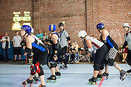 The Sacred City Derby Girls hosted the Santa Cruz Derby Girls in Sacramento, California in a flat track roller derby bout. Sacred City won.