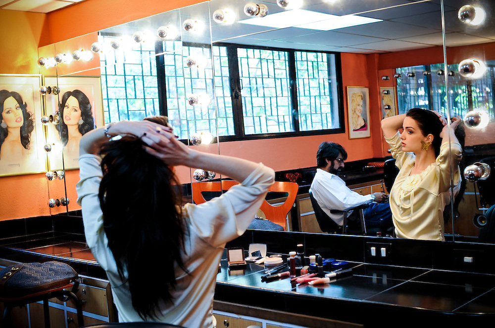 Adriana Vasini Sanchez, 22, Miss World Venezuela 2009 and recently crowned Miss Hispanoamerica (Hispanic America Queen) 2009 practices applying make-up with her beauty professors at the La Quinta Miss Venezuela School in Caracas, Venezuela. The school, directed by Osmel Sousa, is famed for producing winning beauty queens.  In 2009 Venezuela set a record by winning  consecutive Miss Universe crowns. Beauty queens are highly regarded in the South American country, and a source of incredible national pride.