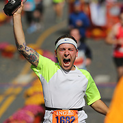 The Finish Line. Expressions of agony and ecstasy on the faces of athletes as Chris Hart, North Branford, Connecticut, finishes  the ING Hartford Marathon, Bushnell Park, Hartford. Connecticut. USA. Hartford, Connecticut, USA. 12th October 2013. Photo Tim Clayton