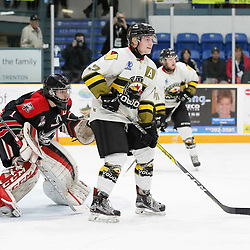 TRENTON, ON  - MAY 5,  2017: Canadian Junior Hockey League, Central Canadian Jr. &quot;A&quot; Championship. The Dudley Hewitt Cup. Game 7 between The Georgetown Raiders and The Powassan Voodoos.  Parker Bowman #17 of the Powassan Voodoos and Josh Astorino #1 of the Georgetown Raiders during the play in the first period <br /> (Photo by Amy Deroche / OJHL Images)
