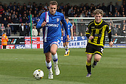 Gillingham midfielder Doug Loft on the ball during the Sky Bet League 1 match between Burton Albion and Gillingham at the Pirelli Stadium, Burton upon Trent, England on 30 April 2016. Photo by Aaron  Lupton.