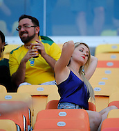 A female fan in the crowd during the 2014 FIFA World Cup match at Arena da Amazonia, Manaus<br /> Picture by Andrew Tobin/Focus Images Ltd +44 7710 761829<br /> 14/06/2014